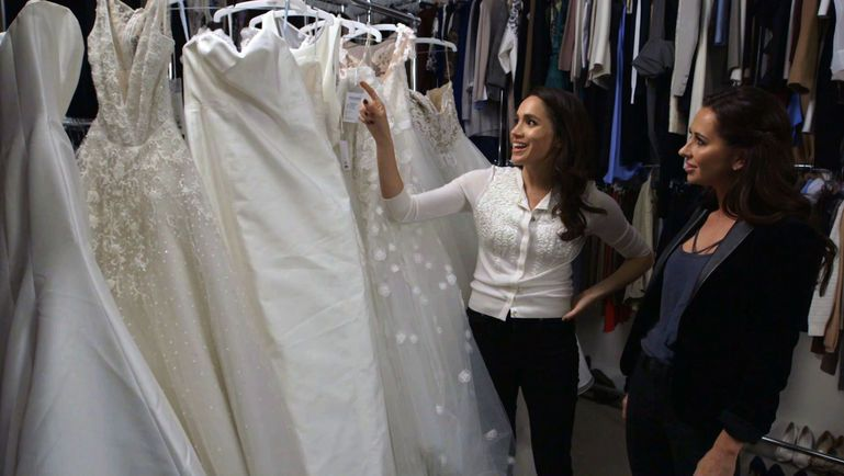 Meghan Markle looking at wedding dresses