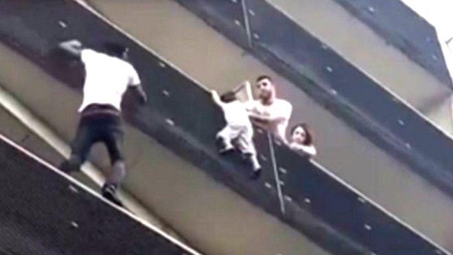 Gassama climbs up an apartment building to save a toddler