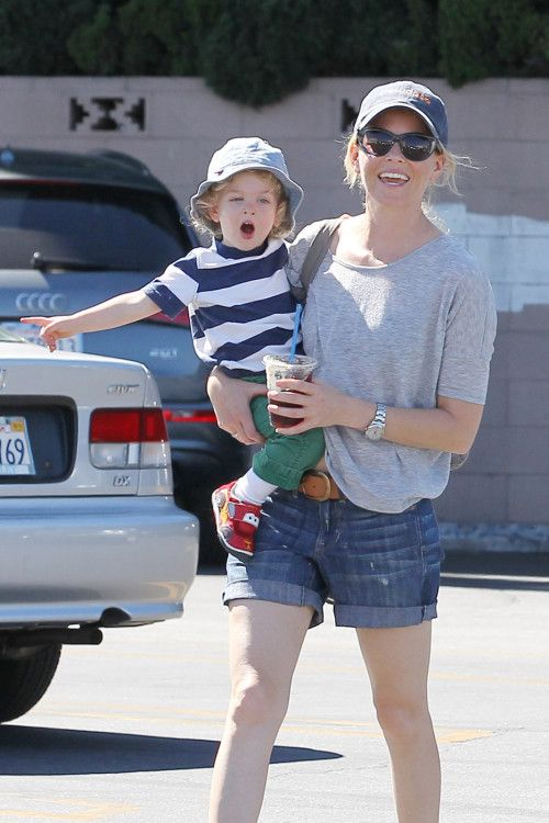 Elizabeth Banks with her son in a parking lot
