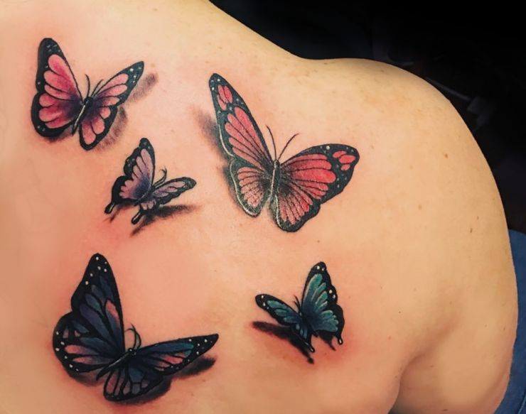 Multiple butterfly tattoos