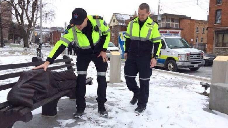 Paramedics check up on the homeless Jesus statue