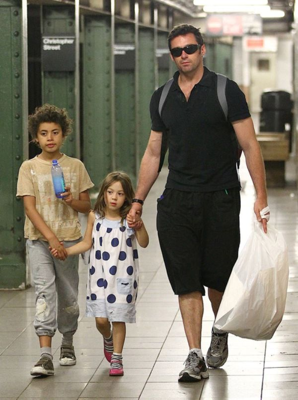 Hugh Jackman walking with his two children