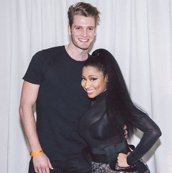 Louis Spencer posing with Nicki Minaj