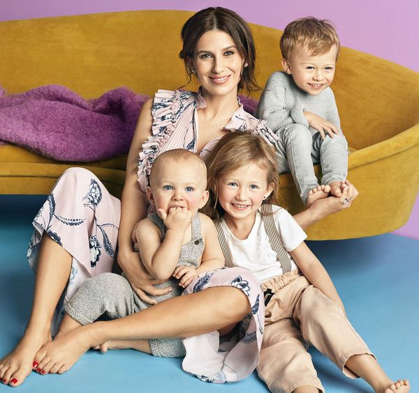 Hilaria Baldwin posing with three out of her four children.