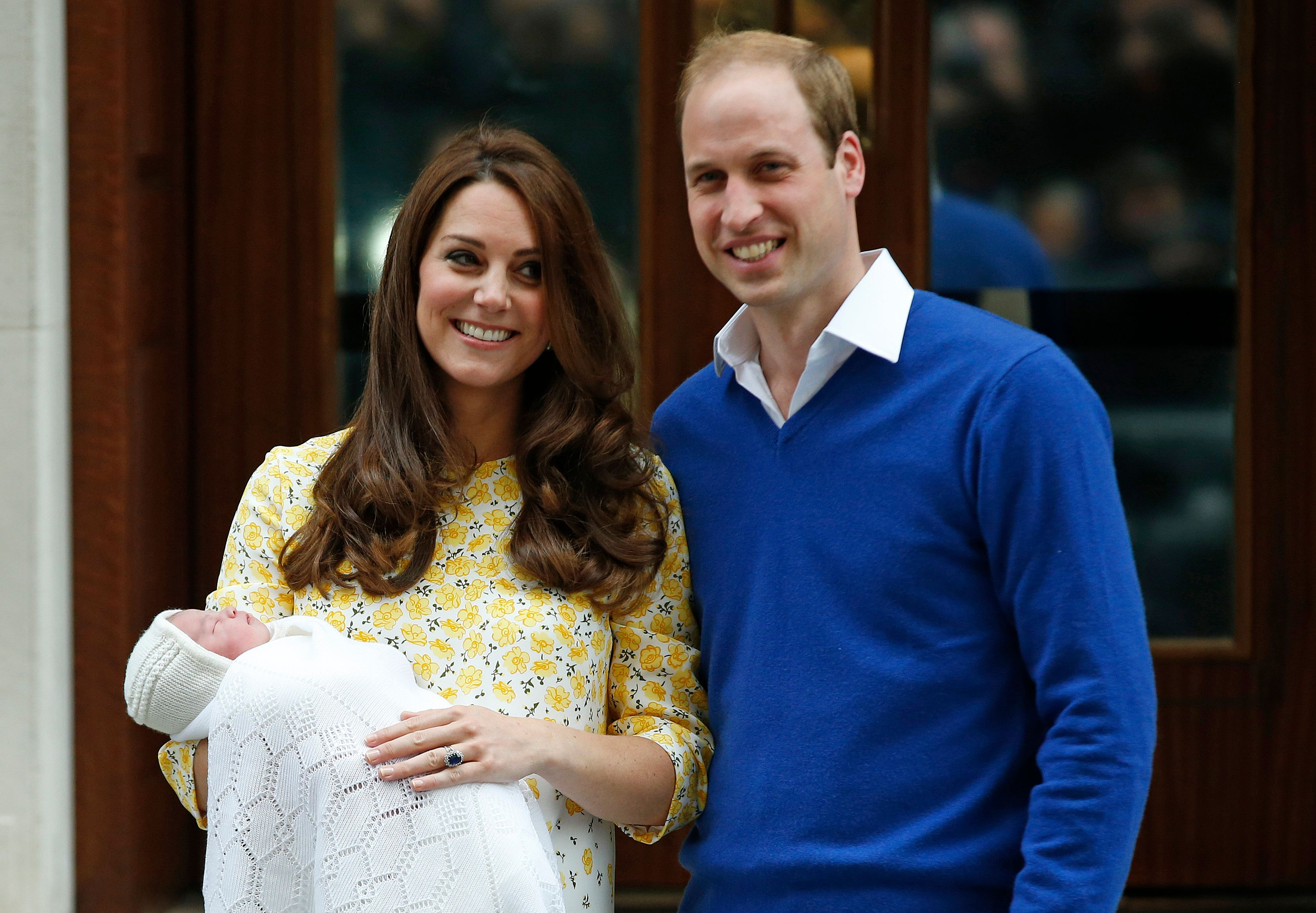 Prince William and Kate Middleton introducing Princess Charlotte to the world