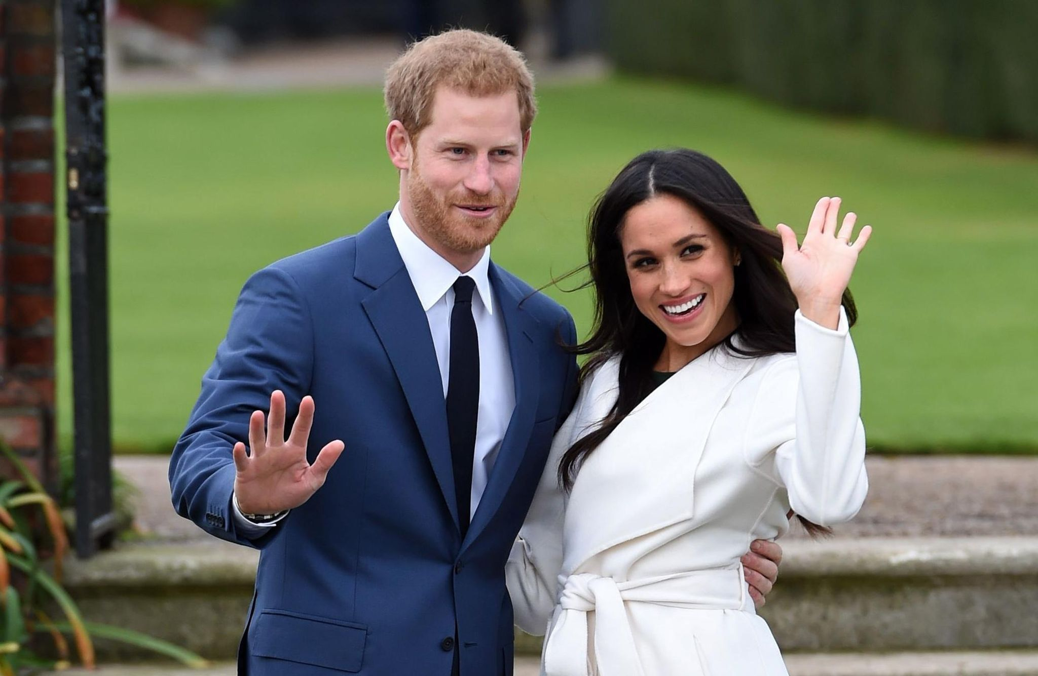 Prince Harry and Meghan Markle posing for the cameras