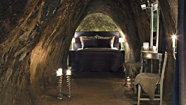 A hotel bedroom inside a cave