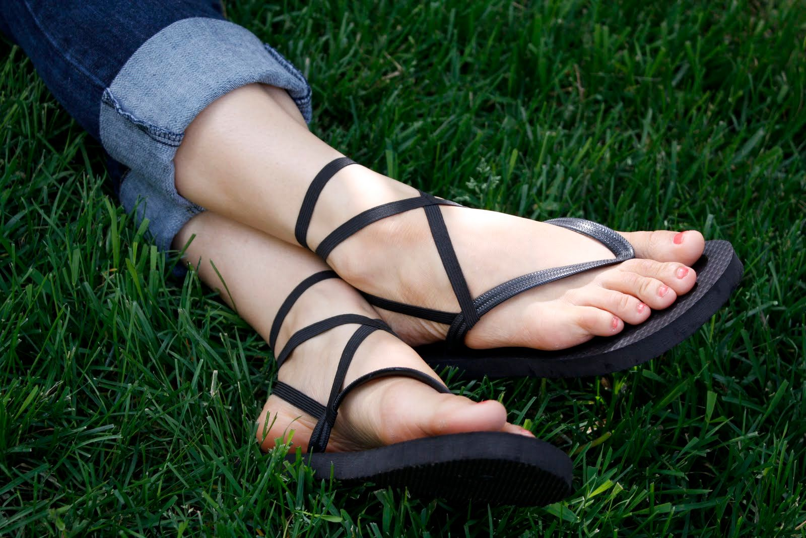Someone wearing flip-flops in the grass