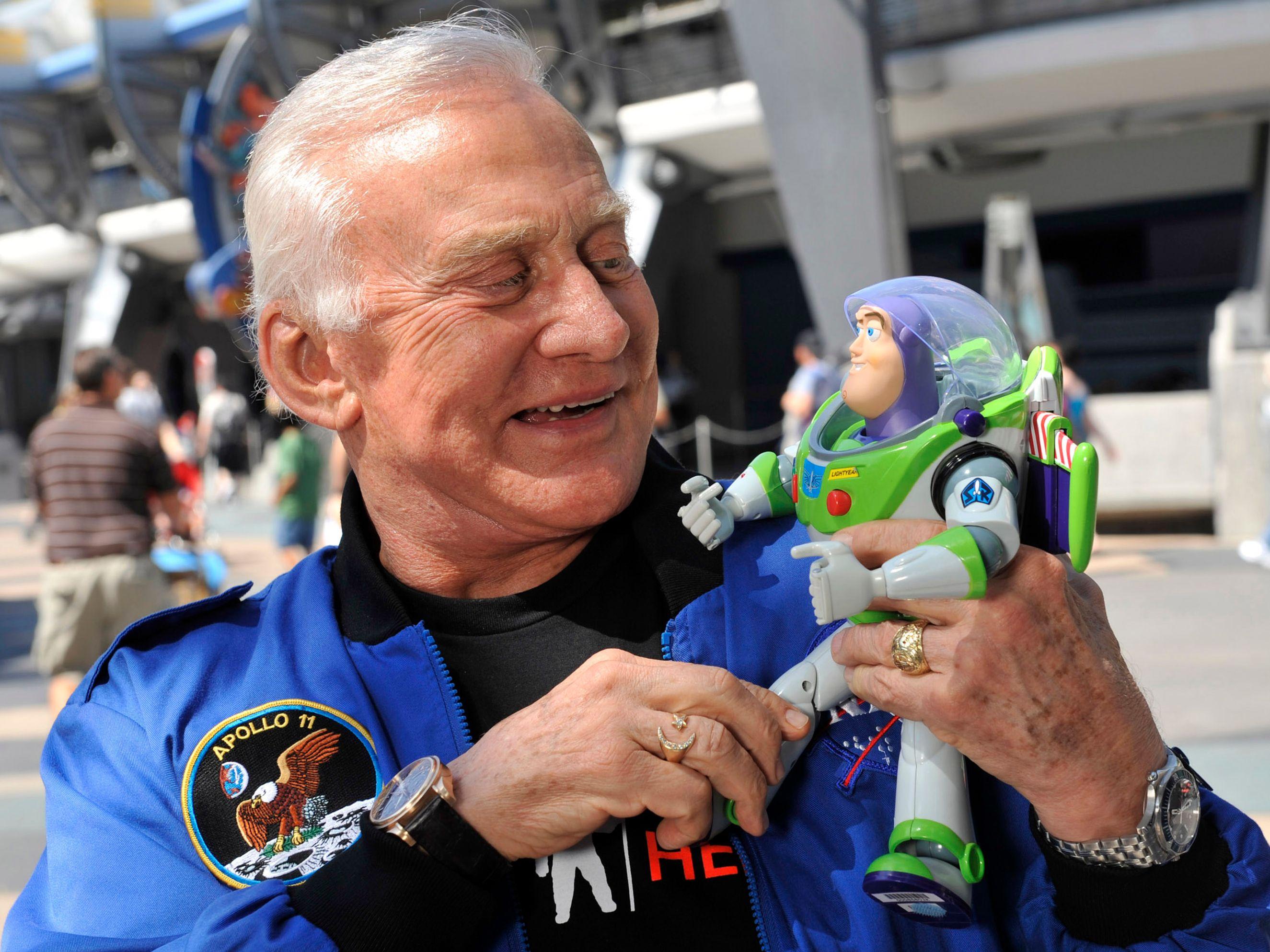 Buzz Aldrin with a toy Buzz Lightyear