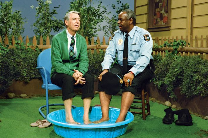 Mr. Rogers and a police officer in a kiddie pool.