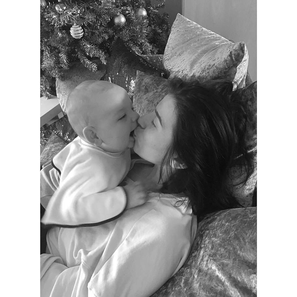 Elishia Donnellan kissing her son Caelan
