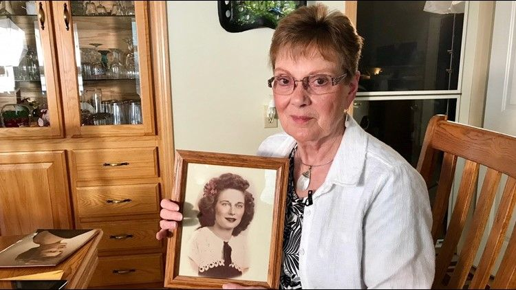 Linda Jourdeans shows off a photo of Rochelle Nielsen, the woman she believed was her mother