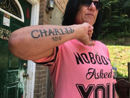 Beth Campbell shows off her tattoo for Charlee