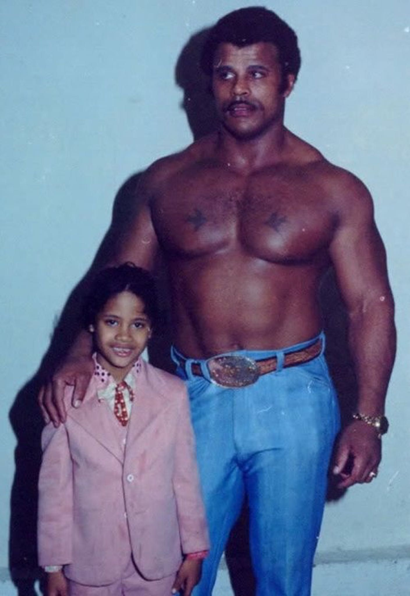 A young Dwayne Johnson with his dad Rocky