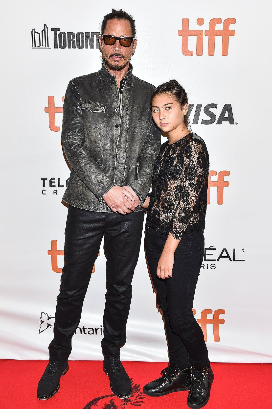 Chris Cornell posing with his daughter Toni on a red carpet