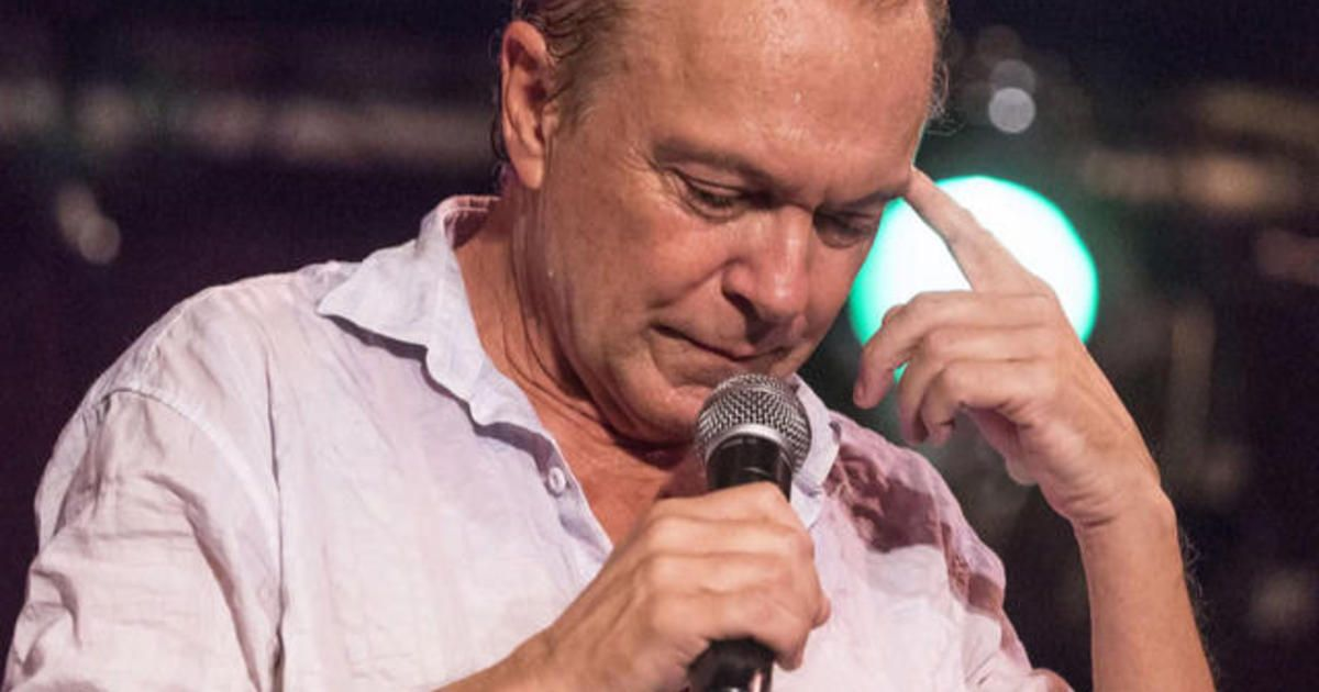 David Cassidy talking into a mircophone