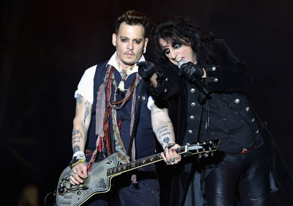 Johnny Depp performing with his band