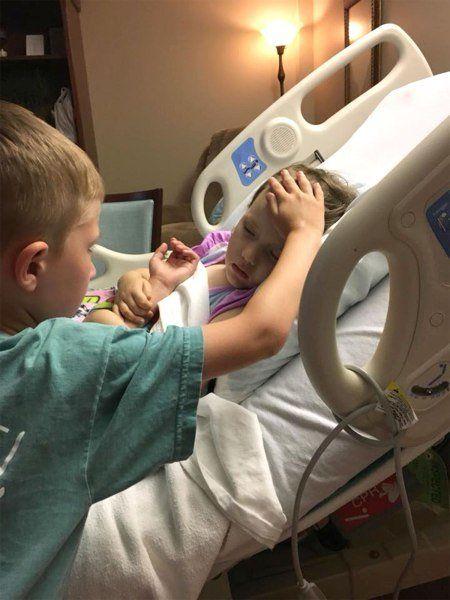 Jackson comforting his sister, Adalynn