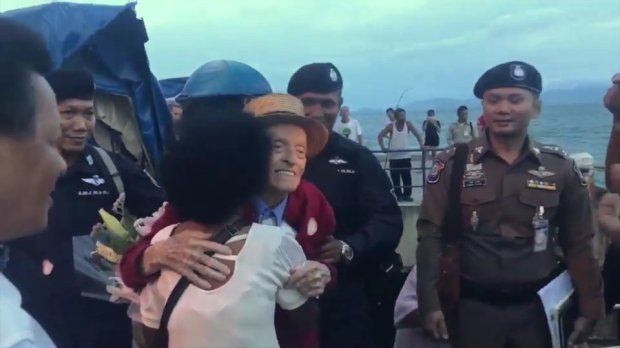 The couple embrace after being reunited