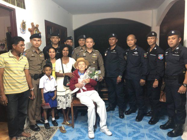 The couple with the tourist police who reunited them