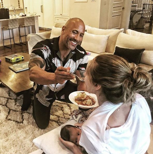 The Rock feeding his girlfriend as she breastfed their daughter