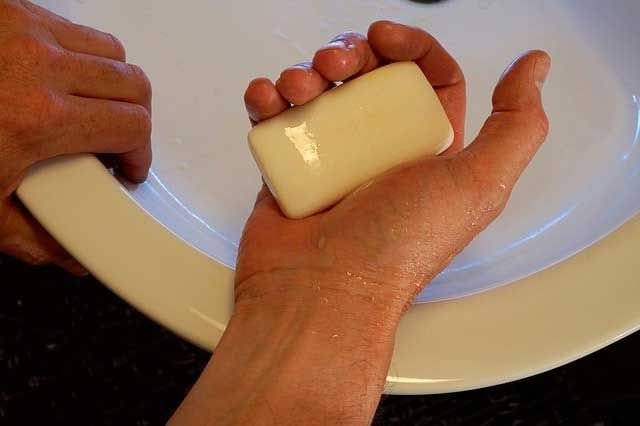 A person holding soap