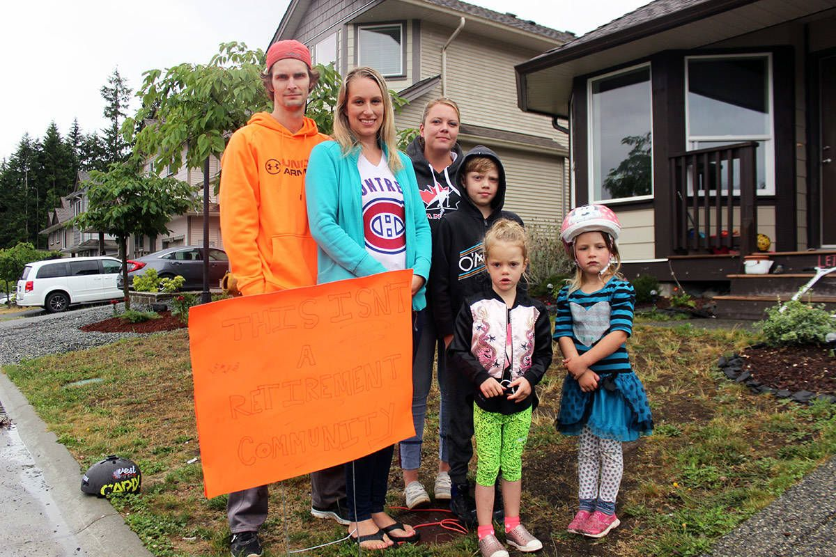 A family protesting the new bylaw