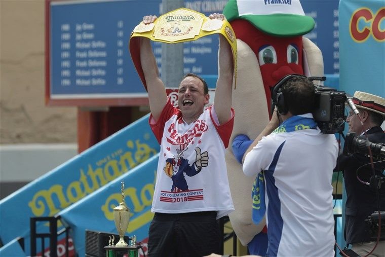 Joey Chestnut with his winning belt