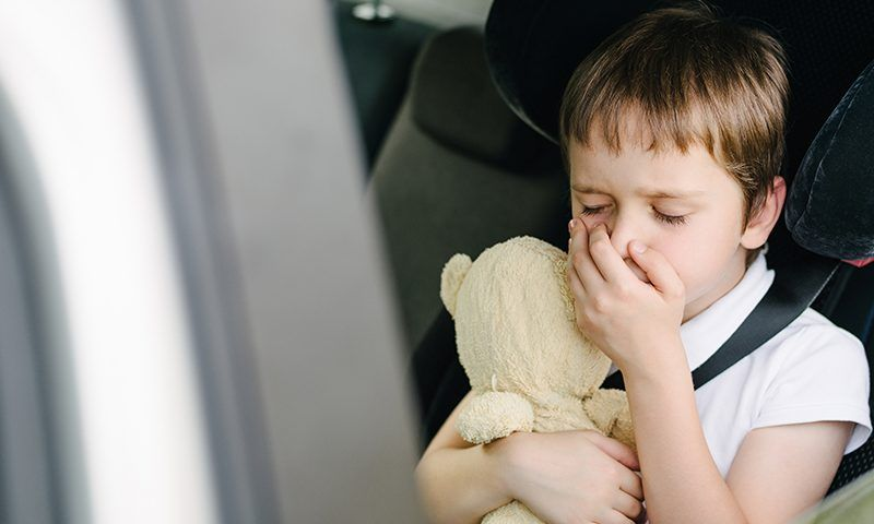 A boy having motion sickness