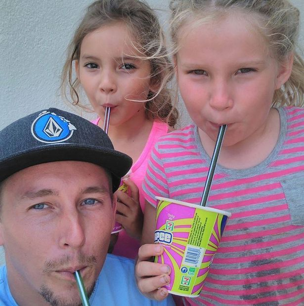Adam Schaub and his two daughters