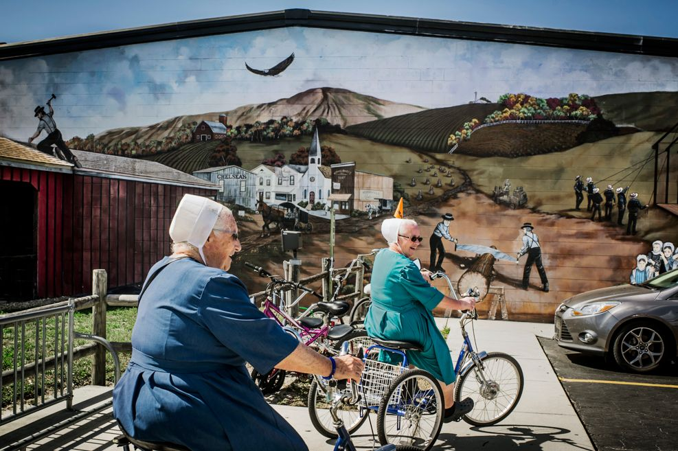 Two Amish women riding bikes
