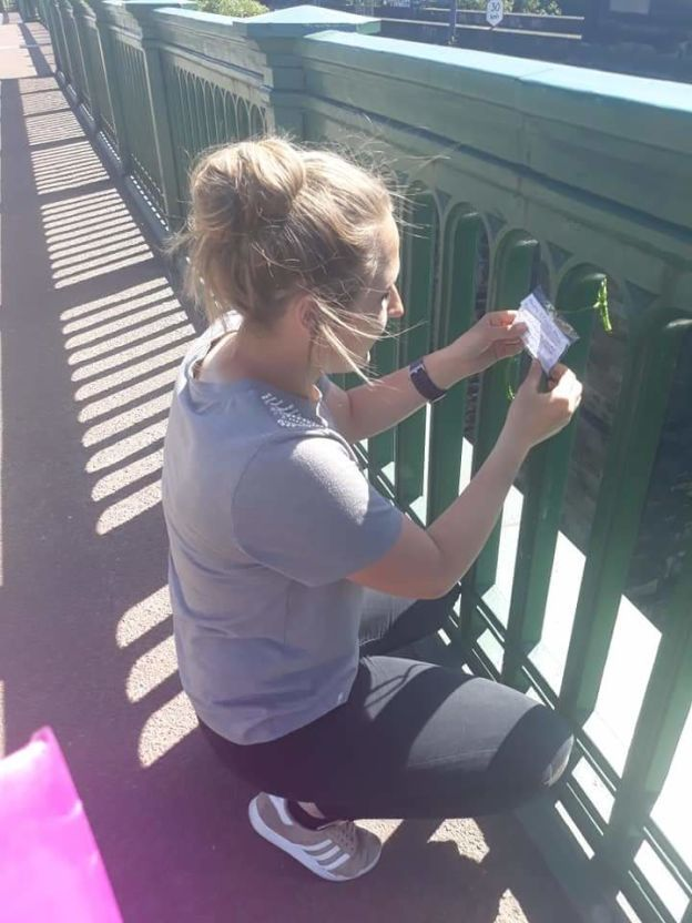 Paige putting a note on the bridge