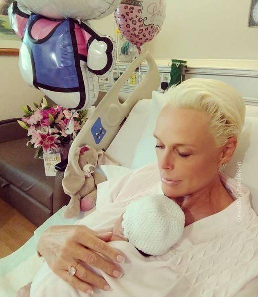 Brigitte holding her newborn daughter