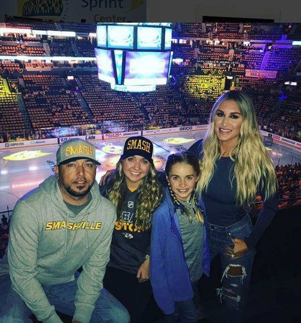 Brittany, Jason his kids at a hockey game
