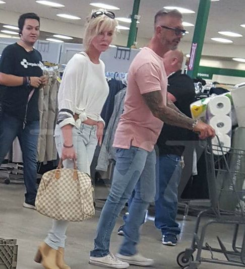 Larry shopping with his new girlfriend