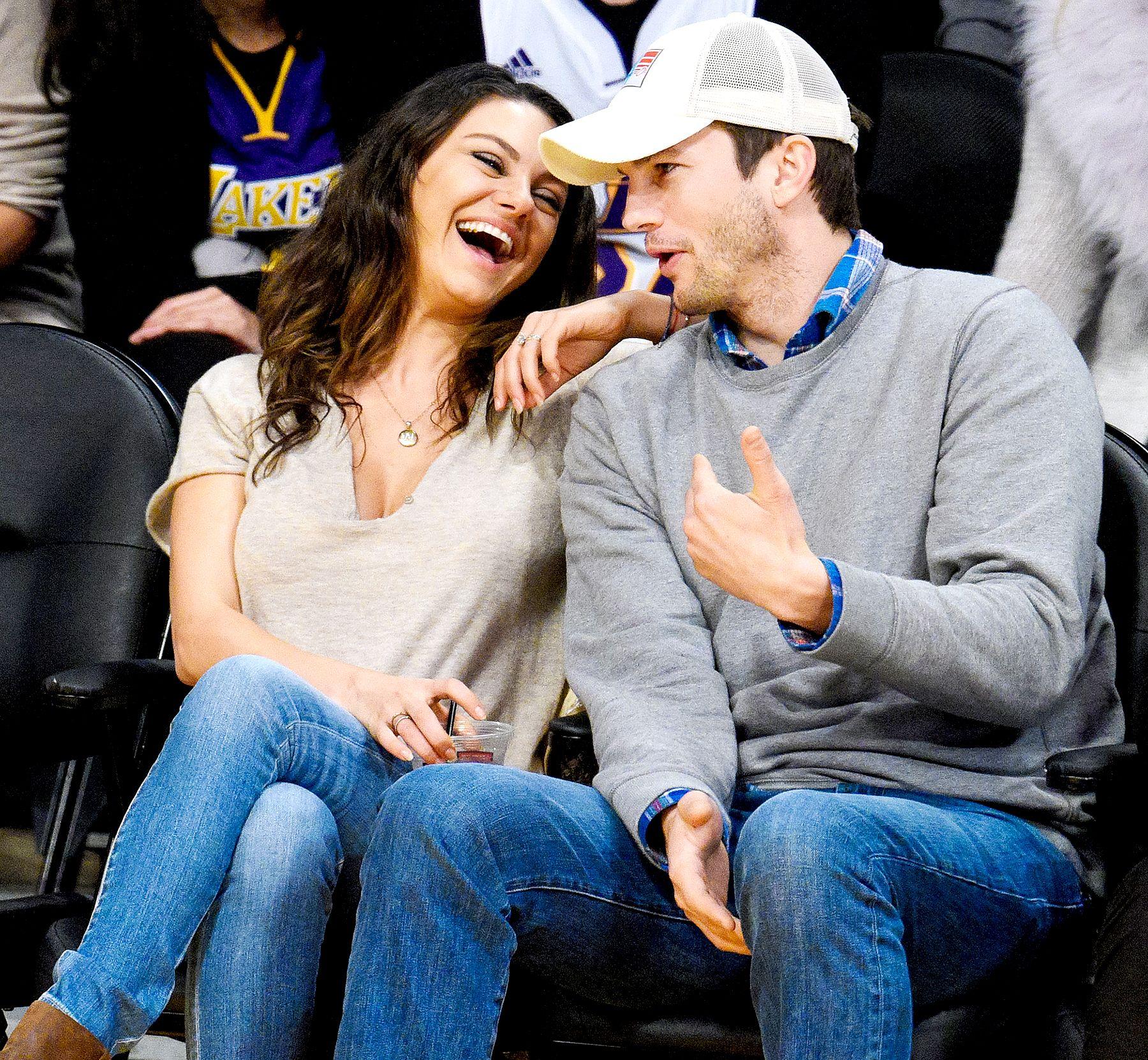 Mila Kunis and Ashton Kutcher at a basketball game