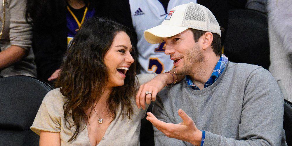 Ashton Kutcher and Mila Kunis at a basketball game