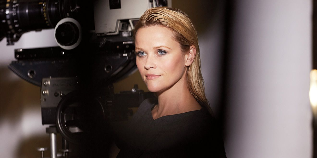 Reese Witherspoon with a camera