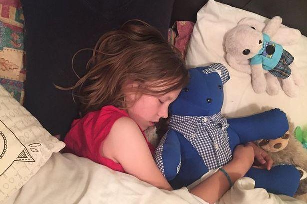 Bethan sleeping with her teddy bear