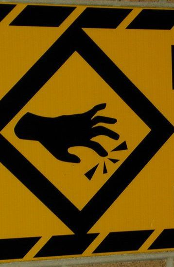 caution sign hands