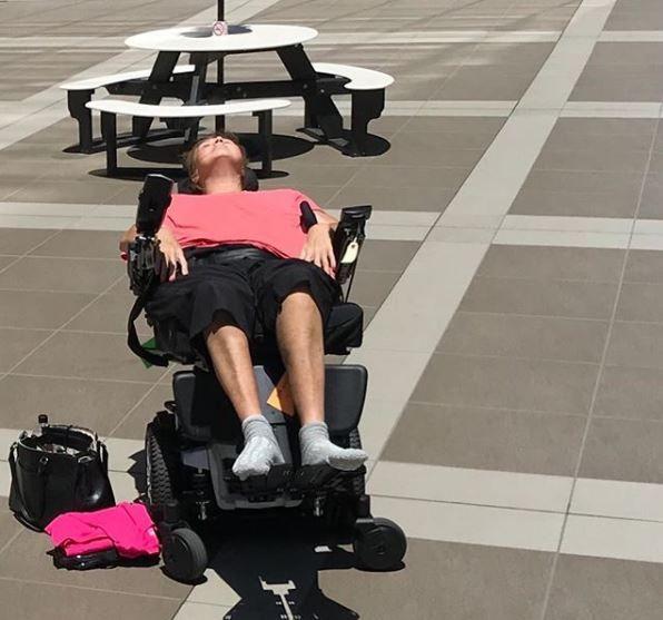 Abby in a wheelchair