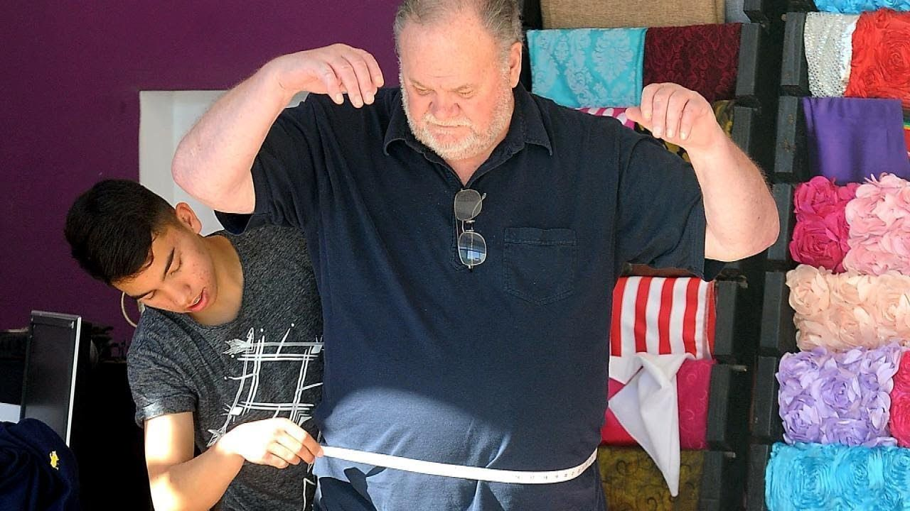Thomas Markle being measured for his suit.