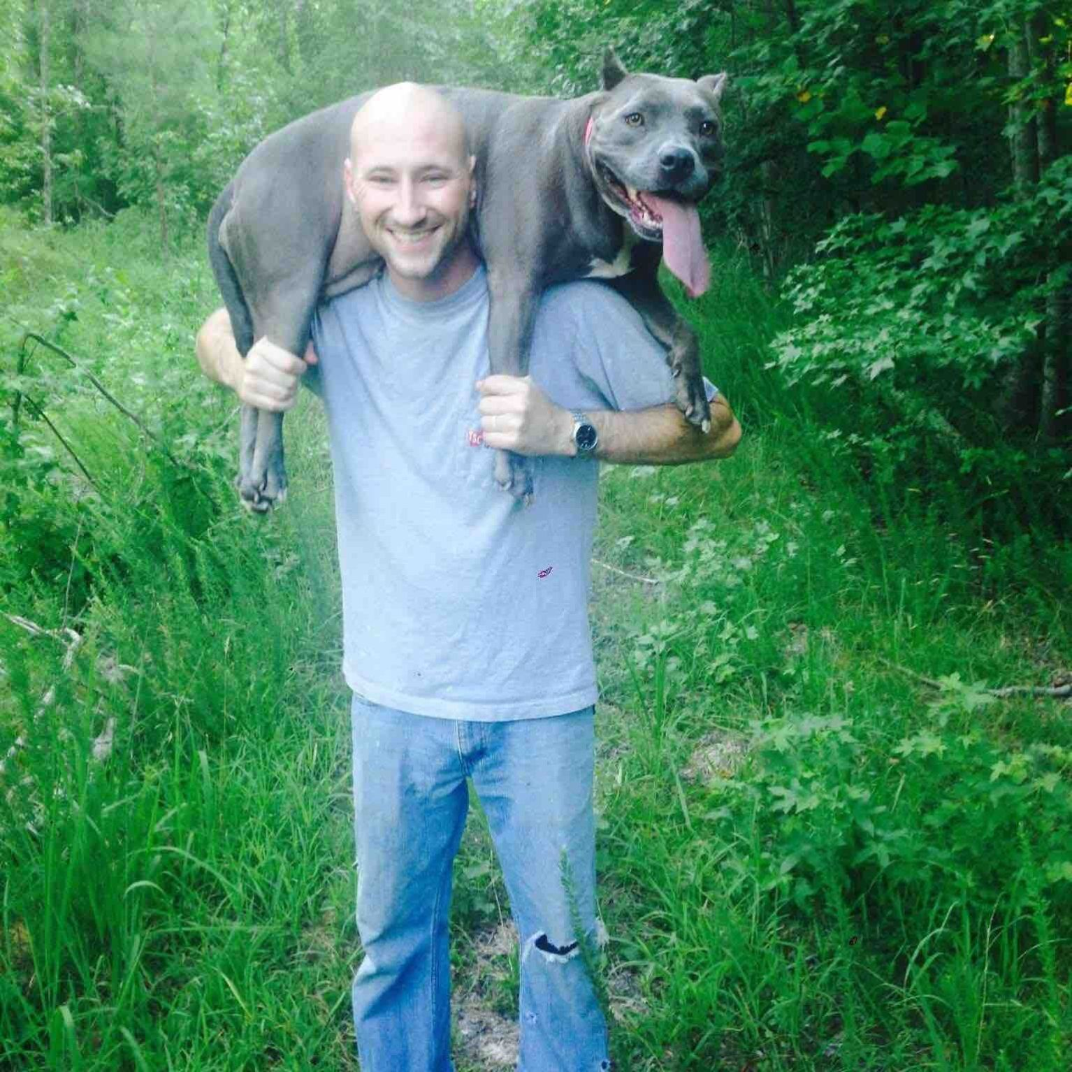 Johnny Bobbitt Jr and a dog