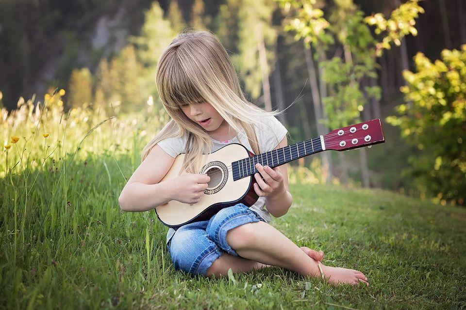 girl playing music