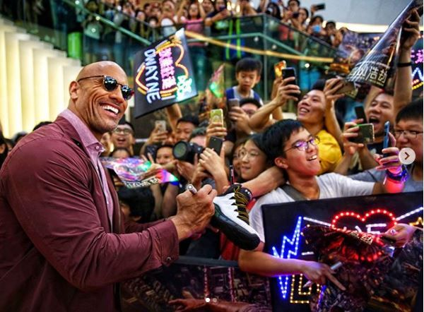 The Rock signing autographs