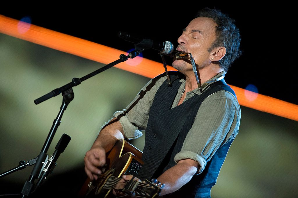 Bruce Springsteen performing at a concert