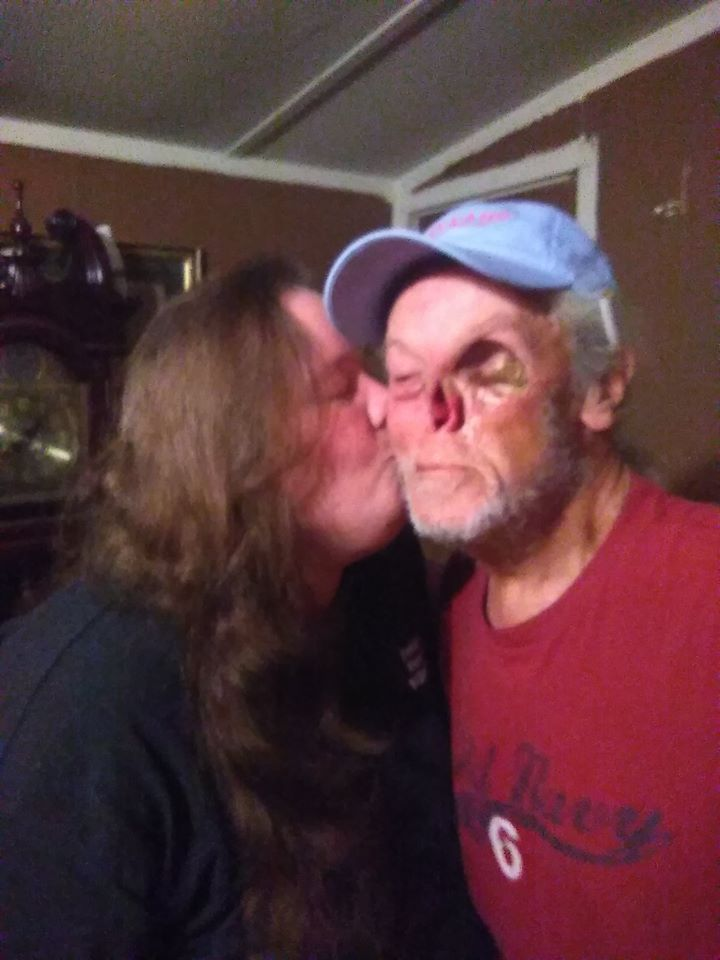 Brandy Evans giving her dad a kiss on the cheek
