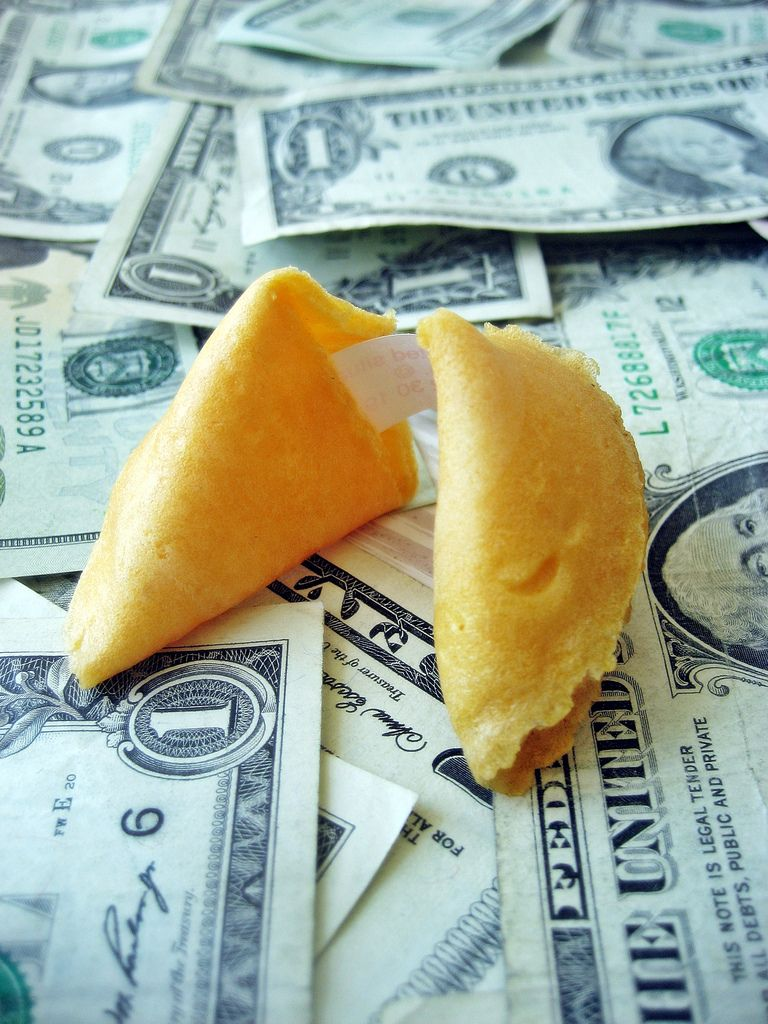 Fortune cookie on money