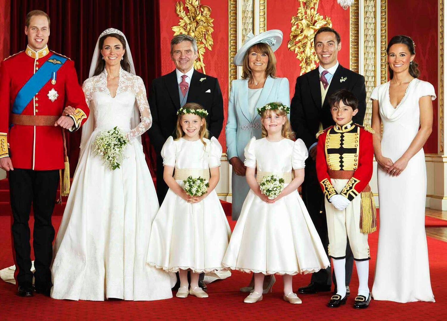 Kate Middleton and Prince William pose with the Middletons on their wedding day