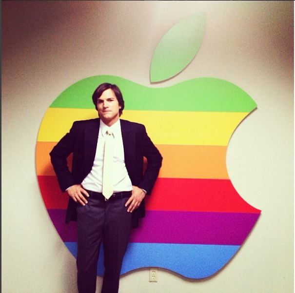 Ashton Kutcher in front of the Apple logo